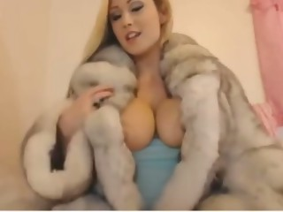 Candi in fur smoking