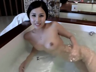 Petite asian beauty takes bath on cam