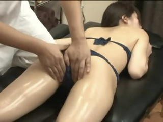 Handsome Asian minx enjoys erotic massage