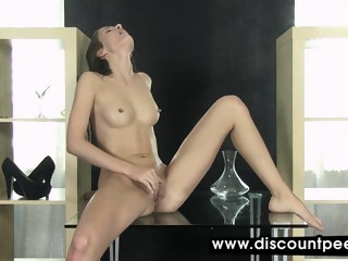 Stunning brunette seductively pisses in this scene